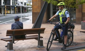 A police officer talks to a member of the public during the first day of a nationwide lockdown to stop the spread of Covid-19,