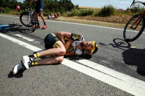 Lotto-Jumbo rider Laurens ten Dam lies on the ground after a fall
