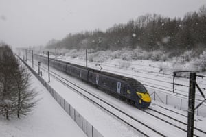 The Eurostar passes through snow on its way to the Channel Tunnel