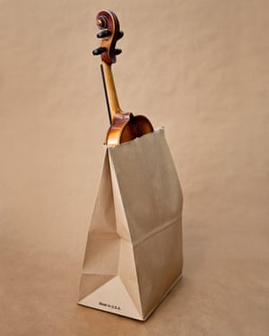 A violin in a paper bag, from photographer Olivia Locher's I Fought the Law series