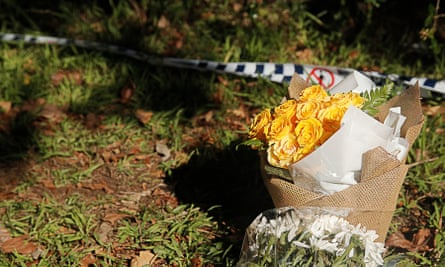 Flowers at a property in West Pennant Hills, Sydney, where a father killed his 15-year-old son and 13-year-old daughter with handguns he legally bought.