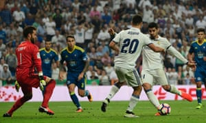 Real Madrid's forward Alvaro Morata (R) kicks the ball to score during the Spanish league football match Real Madrid CF vs RC Celta de Vigo at the Santiago Bernabeu stadium in Madrid on August 27, 2016. / AFP PHOTO / PIERRE-PHILIPPE MARCOUPIERRE-PHILIPPE MARCOU/AFP/Getty Images