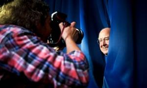 Professor Peter Higgs being a good sport, peeking from behind a curtain