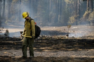 Troy Drouin, a firefighter, takes a break before mopping up hot spots near Yosemite.