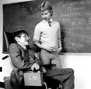 Graduate assistant Colin Williams talking to physicist Stephen Hawking at Harvard University in April 1984