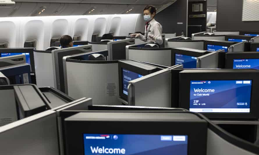 A flight attendant in the business class section of a British Airways flight in December