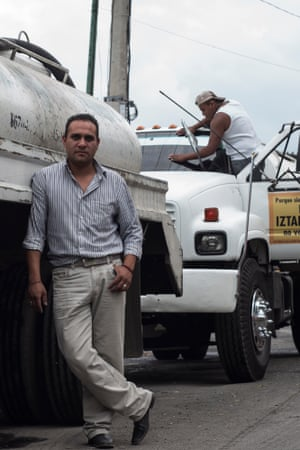 Adrian Vasquez with his water delivery truck. Vazquez lives in the community he serves and knows the tensions around water provision only too well.