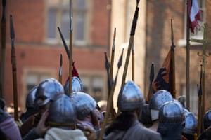 Re-enactors in full battle gear line up in York Minster