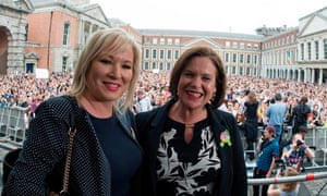 Sinn Féin's president Mary Lou McDonald, right, and Michelle O'Neill, leader of the party in the Northern Ireland assembly, celebrate at Dublin castle
