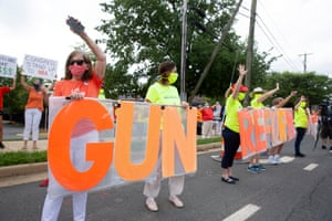 Gun control reform advocates protest outside the National Rifle Association headquarters in Fairfax, Virginia, on 14 August.