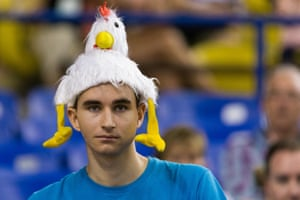 A France fan adornes a chicken hat for the game against South Korea