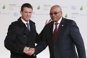 South Africa's President Jacob Zuma, right, is greeted by French prime minister Manuel Valls as he arrives for the COP21 conference on Monday