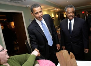 Barack Obama, left, and the Rev. Al Sharpton greet patrons at the soul food restaurant, Sylvia's, before an Obama fundraiser in the Harlem section of New York, Thursday, Nov. 29, 2007.