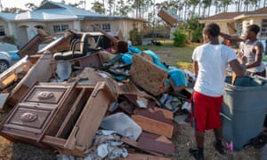 Residents of Heritage Community throw out their damaged property after the floods caused by Hurricane Dorian, in Freeport, Grand Bahama, on Sunday.