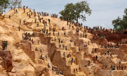 Prospectors working at an open-pit gold mine in Central African Republic