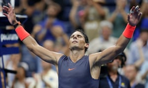 Rafael Nadal raises his hands to the sky after defeating Dominic Thiem.