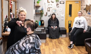 Jessica Barrett (centre) and Louise Fletcher (cutting hair) at Locks barbers