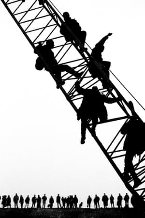 January 1997. Protesters occupy a crane on the site of the Newbury bypass during a mass action to mark the first anniversary of the start of construction.