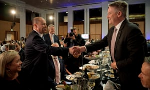 Federal treasurer Josh Frydenberg (L) shakes hands with the finance minister Mathias Cormann as he arrives to deliver his budget address at National Press Club on 3 April 2019 in Canberra, Australia.