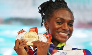 Dina Asher-Smith poses with her three medals at the IAAF World Athletics Championships in Doha, Qatar, last weekend. Asher-Smith won gold in the 200m, silver in the 100m and another silver in the 4x100m relay