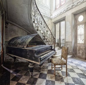 a piano in a grand but abandoned hallway in a photo from abandon on instagram