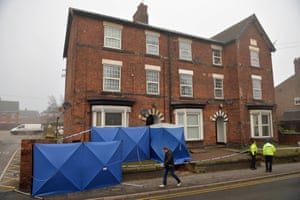 Police set up screens outside a property in Stafford that is being searched following the stabbings in London.