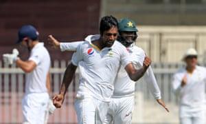Pakistan's Rahat Ali celebrates taking the wicket of Adil Rashid.