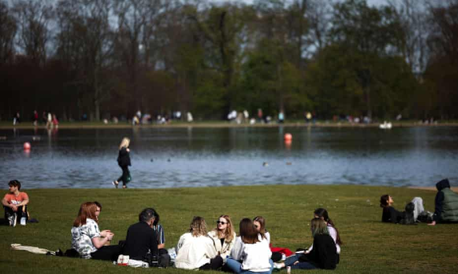People gather in Hyde Park, west London, as Covid lockdown restrictions are lifted.