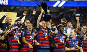 Michael Bradley hoists the trophy as he celebrates with team-mates after defeating Jamaica in the Concacaf Gold Cup final.