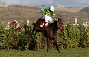 Easysland jumps the final fence ahead of Tiger Roll and goes on to win the Cross Country Chase.