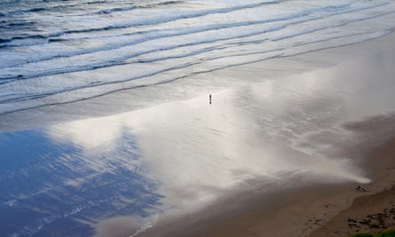 Solitary figure on Welsh beach