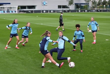 Georgia Stanway (centre left) and Ellen White (centre right) during a training session at Manchester City Football Academy in July.