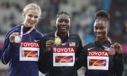 Darya Klishina, left, shares the long jump podium with the American winner, Brittney Reese, and Tianna Bartoletta of the US who won bronze.