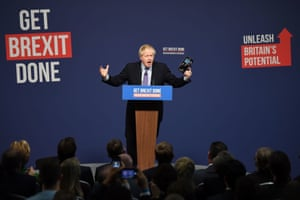 Telford, UKPrime Minister Boris Johnson holds up his party's manifesto during its launch at Telford International Centre