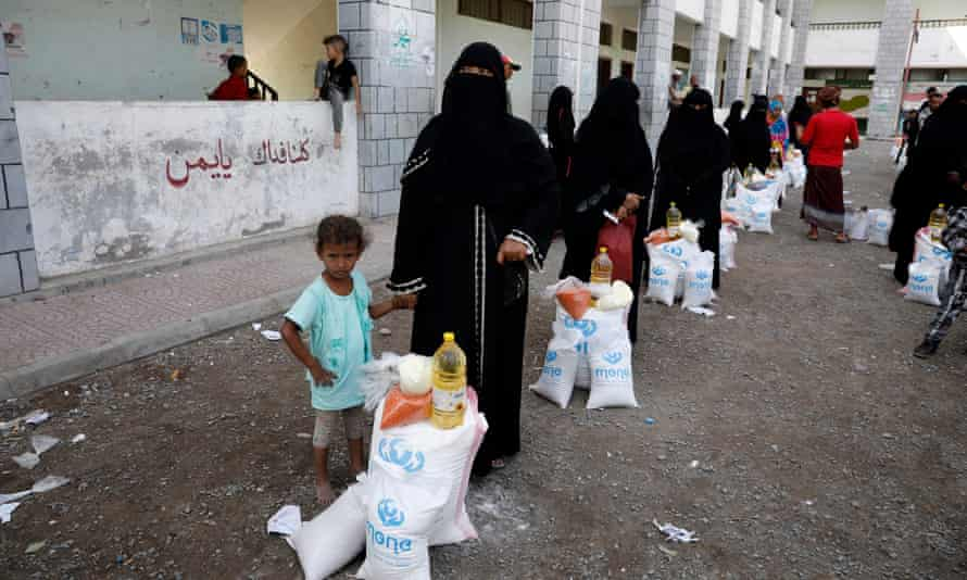 Yemeni women and children collecting their food rations