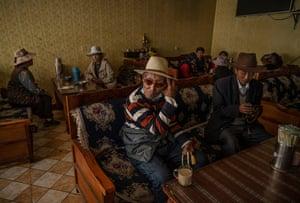 Tibetans sit in a local noodle shop