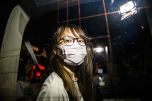 Prominent Hong Kong democracy activist Agnes Chow looks out of a car window while being driven away by police from her home after she was arrested under the new national security law in Hong Kong late on August 10, 2020.