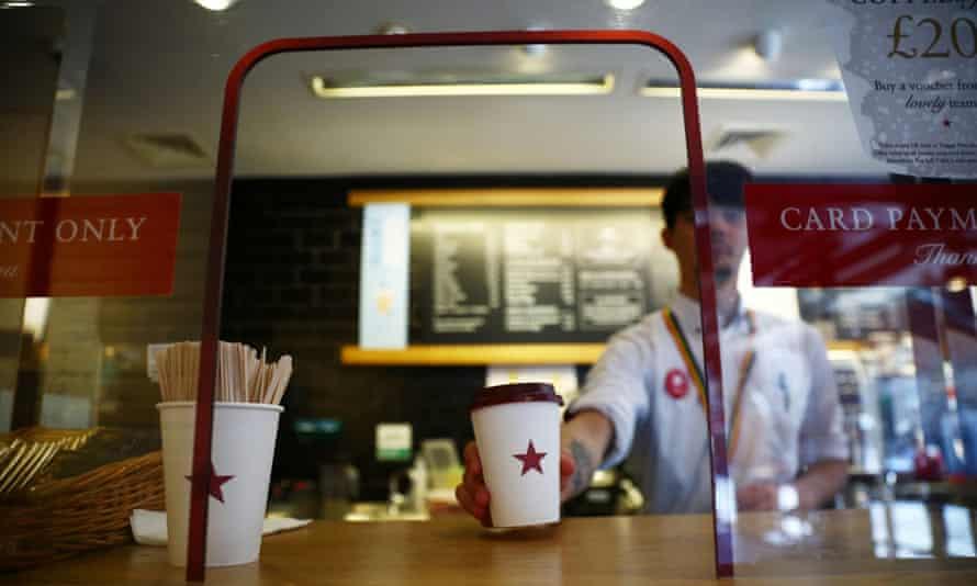 Pret a manger barista serving a coffee