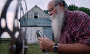 Michael Zahs examining film reel