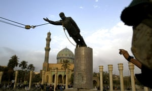 Statue of Saddam Hussein is being pulled down.