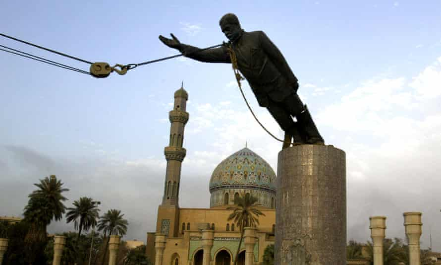 End of tyranny … a statue of Saddam Hussein is toppled in Baghdad, in 2003.