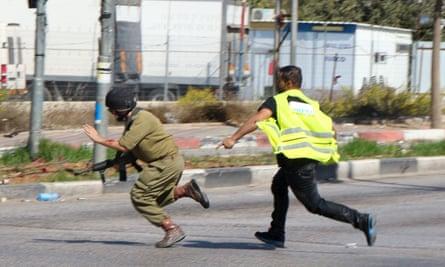 Palestinian attacking Israeli solider