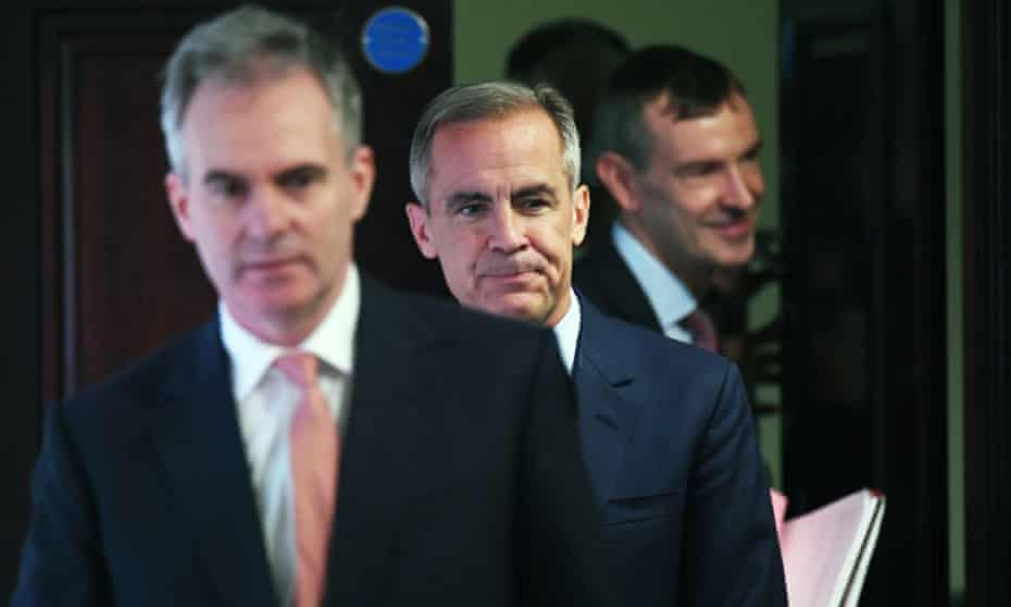 Mark Carney, centre, at the Bank of England