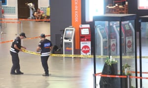 Police cordon off an area of Kuala Lumpur airport on Friday for a re-enactment with a suspect in the death of a Kim Jong-nam.