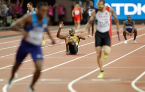 Usain Bolt falls to the ground after pulling up injured in the men's 4x100m final in London.