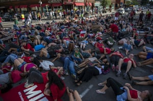 Protesters lie down on the ground during a protest in downtown Minneapolis