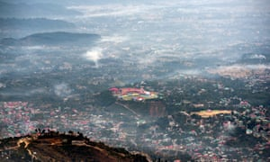 Fires from burning stubble in the fields are seen next to the cricket stadium in Dharmsala, India.