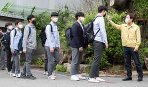 Pupils have their temperature checked at Kyungbok High School in Seoul.