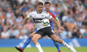 Aleksandar Mitrovic looks to retain possession while under pressure from James Tomkins during Fulham's 2-0 defeat to Crystal Palace at Craven Cottage