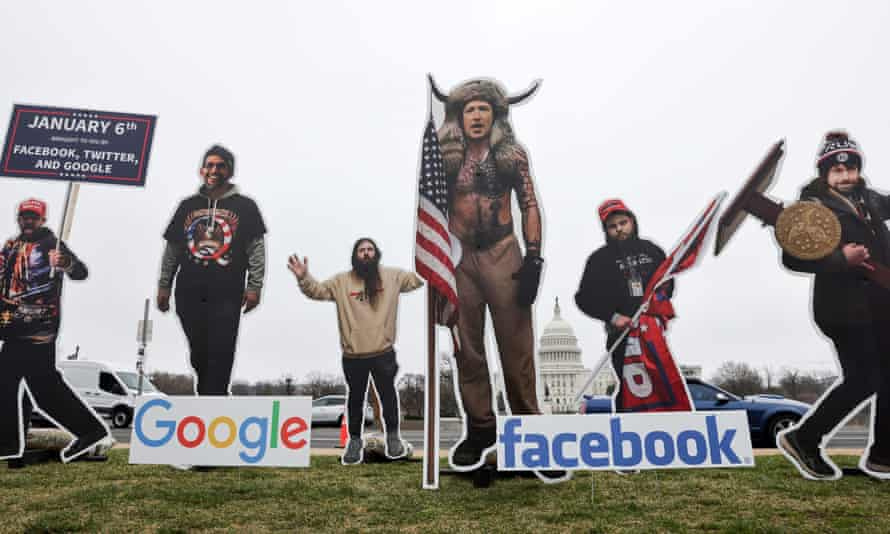 An art installation protest by the organization SumOfUs portrays Sundar Pichai, Jack Dorsey and Mark Zuckerberg as 6 January rioters near the US Capitol.